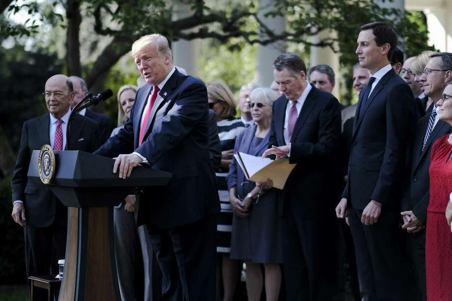 President Donald J. Trump delivers remarks on the United States Mexico Canada Agreement (USMCA) in the Rose Garden at the White House on Monday, Oct. 1, 2018 in Washington, D.C. Photo: Pete Marovich, MBR / TNS / Abaca Press