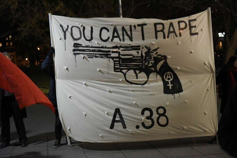 """In this February, 2016 file photo, a """"You Can't Rape a .38"""" banner is seen at Washington Square Park. Several dozen anti-rape activists mustered at Washington Square Park to protest a planned meet up by Return of Kings members whose leader, Roosh V, had argued that rape ought to be legalized. Photo: Pacific Press/LightRocket Via Getty Images"""