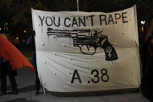 """MANHATTAN, NEW YORK, UNITED STATES - 2016/02/06: """"You Can't Rape a .38"""" banner at Washington Square Park. Several dozen anti-rape activists mustered at Washington Square Park to protest a planned meet up by Return of Kings members whose leader, Roosh V, had argued that rape ought to be legalized. (Photo by Andy Katz/Pacific Press/LightRocket via Getty Images)"""