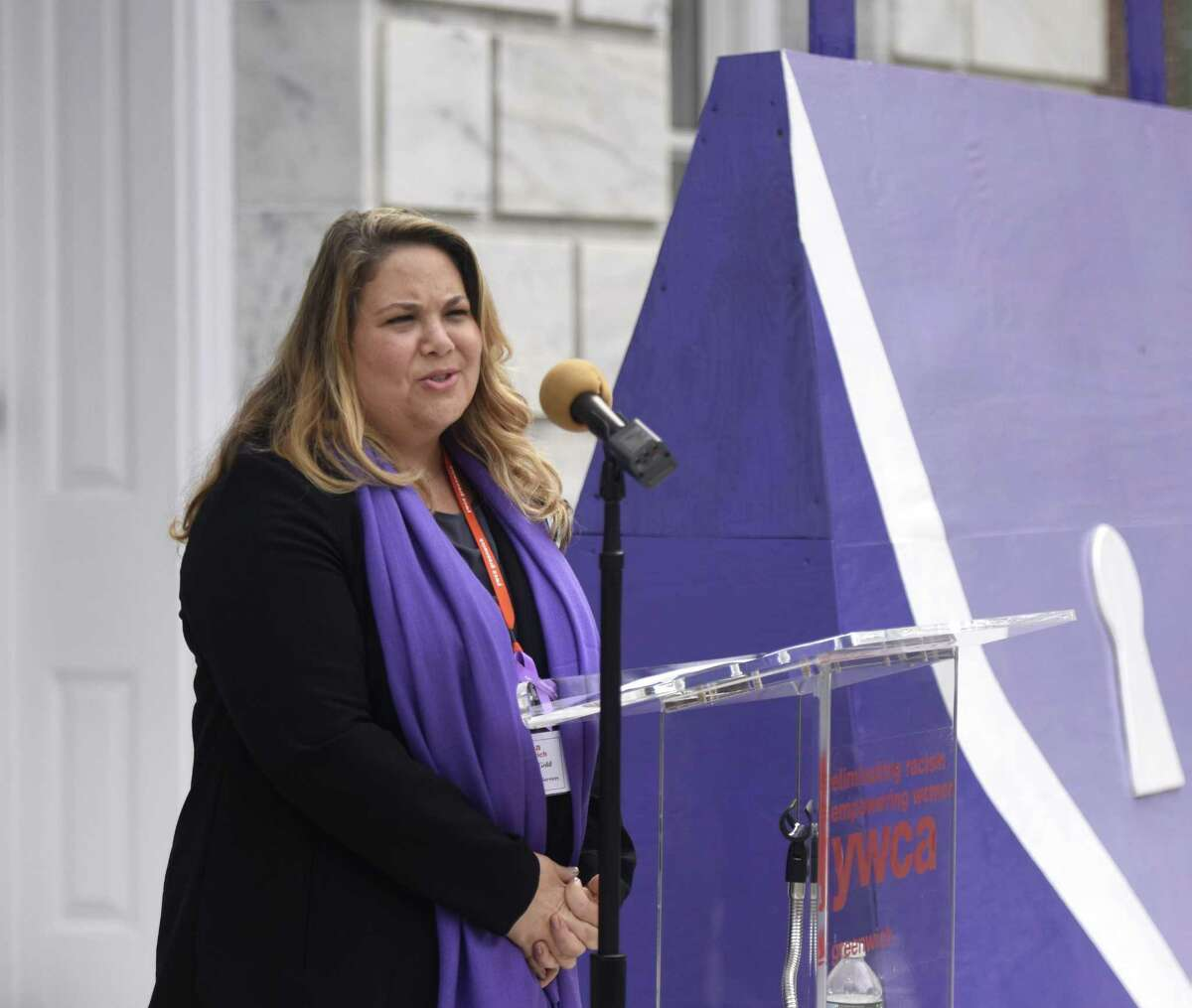 YWCA Greenwich Director of Domestic Abuse Services Meredith Gold speaks during the Domestic Violence Awareness and Prevention Month Kickoff at Town Hall in Greenwich, Conn. Tuesday, Oct. 2, 2018.