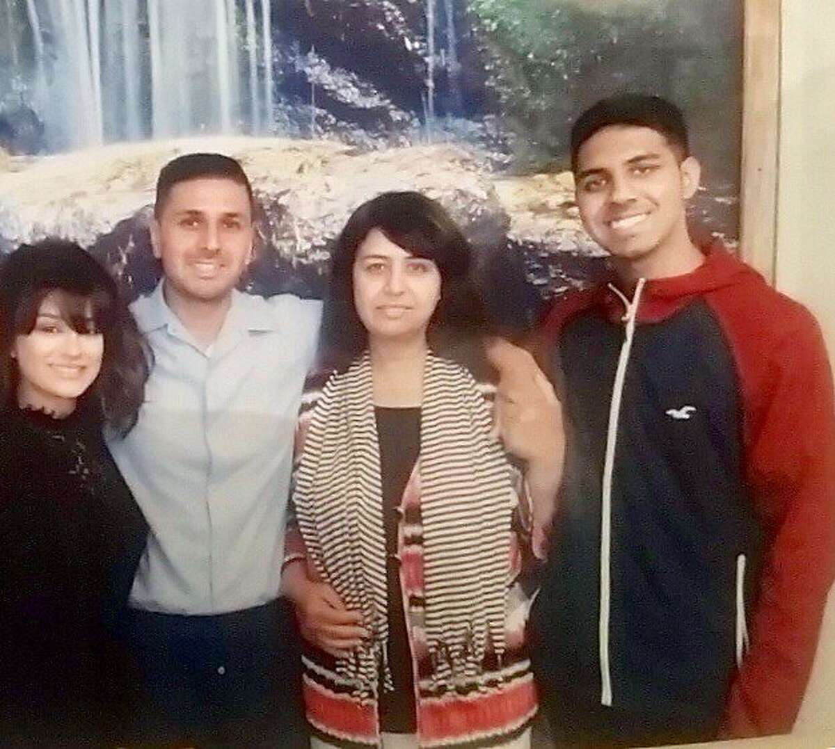 Adnan Khan, second from the left, poses with his family at San Quentin State Prison in June 2017.