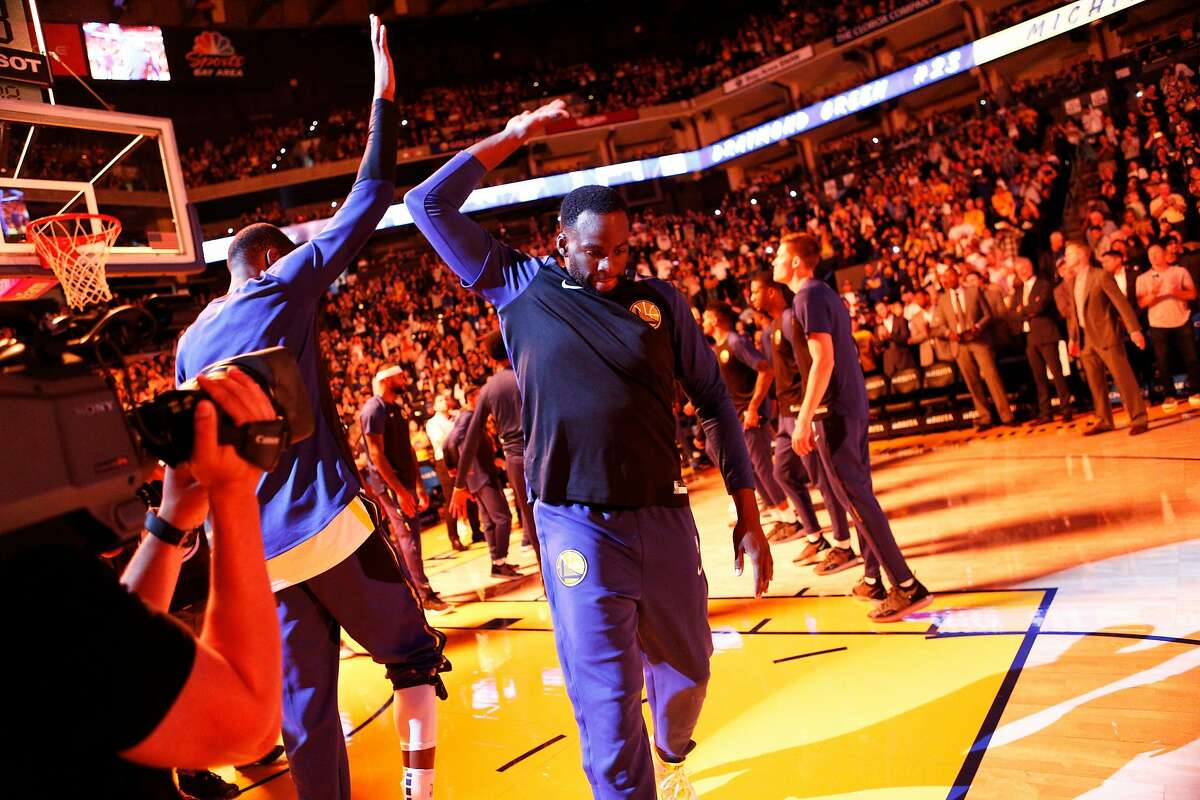 Golden State Warriors forward Draymond Green (23) is introduced before an NBA preseason game between the Golden State Warriors and Minnesota Timberwolves at Oracle Arena on Saturday, Sept. 29, 2018, in Oakland, Calif.