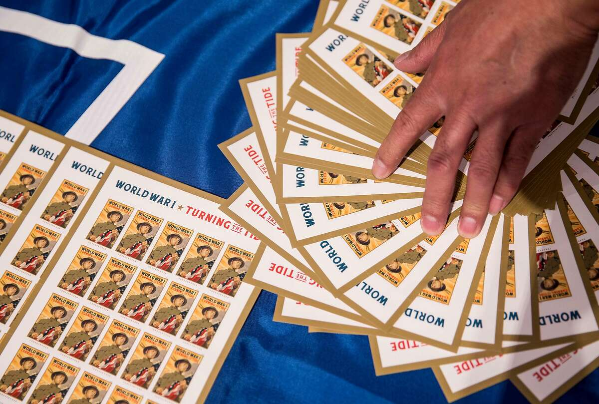 A collectible stamp commemorating the centennial of World War I is seen on display during an unveiling ceremony at the War Memorial Veterans Building in San Francisco, Calif. Tuesday, Oct. 2, 2018.