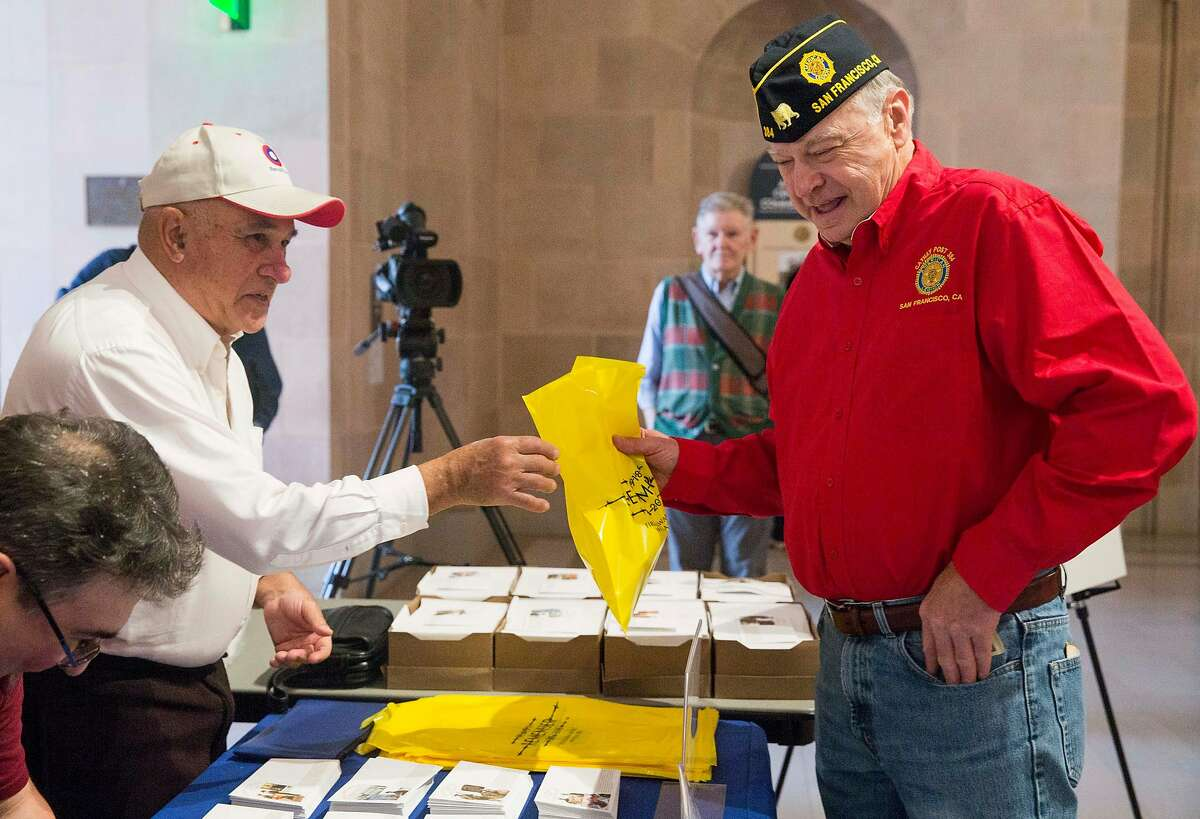 U.S. Vietnam War veteran Sgt. Don Gorwky purchases a commemorative World War I envelope during an unveiling ceremony for a collectible stamp commemorating the centennial of World War I at the War Memorial Veterans Building in San Francisco, Calif. Tuesday, Oct. 2, 2018.