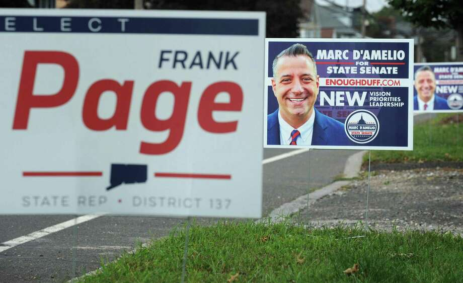 Political campaign signs on the city right-of-way Tuesday, October 2, 2018, in Norwalk, Conn. The city of Norwalk has reminded that placement of campaign signs on city property isnt allowed. The prohibition includes rights-of-way that might extend 10 feet beyond the pavement. Photo: Erik Trautmann / Hearst Connecticut Media / Norwalk Hour