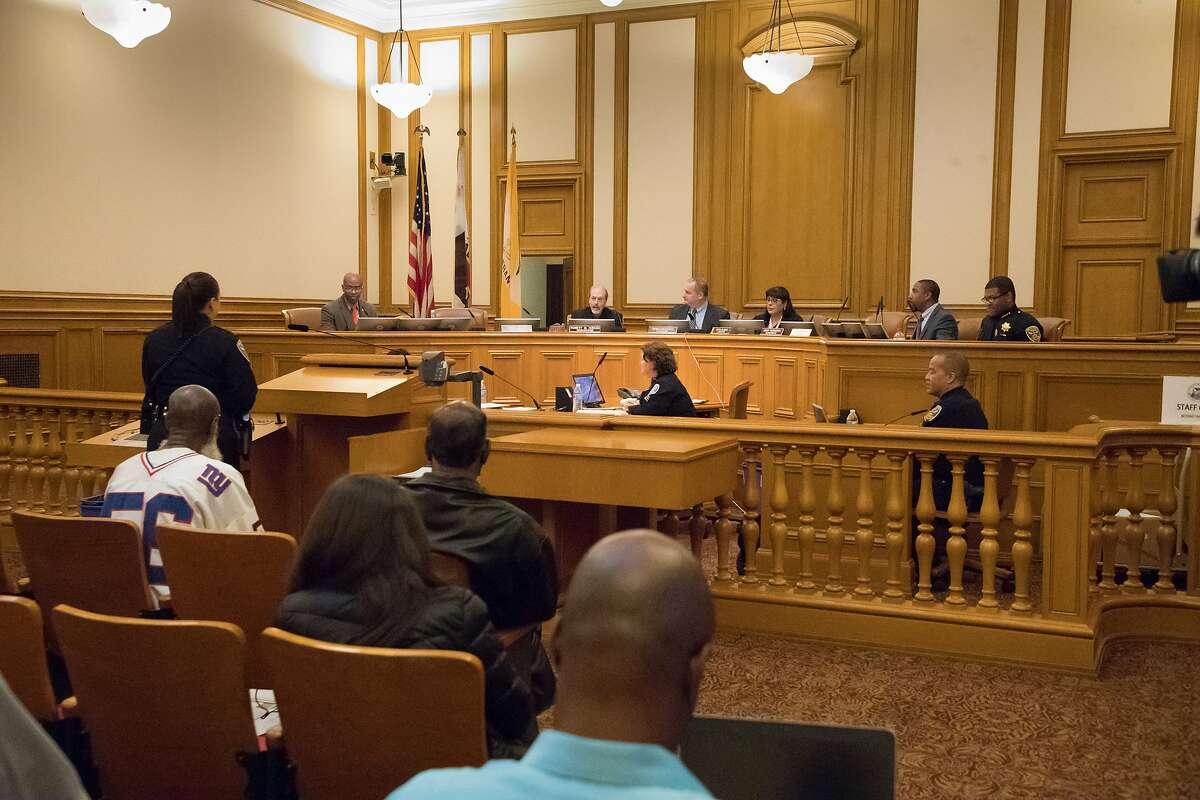 """From left: Paul Henderson, head Department of Police Accountability, commissioners Cindy Elias, Robert Hirsch, V.P. Thomas Mazzucco, Petra DeJesus, John Hamasaki, Dion-Jay Brookter and SF Police Chief William ?'Bill?"""" Scott at a police commission meeting in SF City Hall on Wednesday, Sept. 12, 2018, in San Francisco, Calif."""