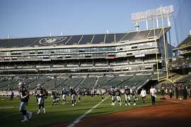 The Oakland Raiders warm up before Week 1 of an NFL Preseason Game against the Detroit Lions at the Oakland Alameda Coliseum, Friday, Aug. 10, 2018, in Oakland, Calif.