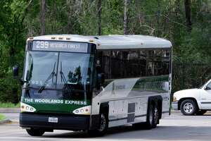 """One of The Woodlands Express buses, a commuter bus service to and from Houston, pulls into the Marisco Place """"Park and Ride"""" location bringing commuters home at the end of the day in The Woodlands, TX, Monday, March 19, 2018. (Michael Wyke / For the Chronicle)"""