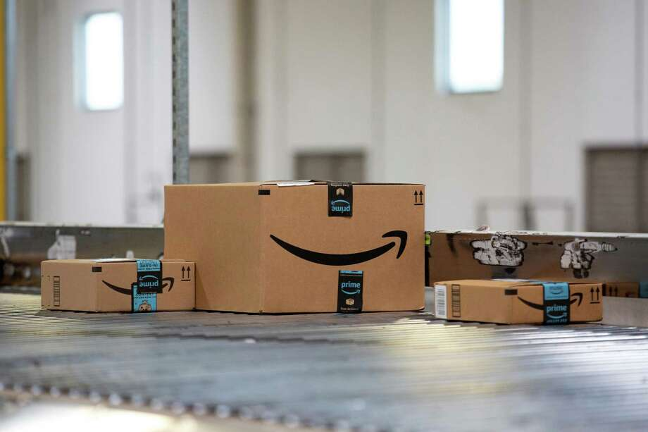 Packages move along a conveyor belt at the Amazon.com Inc. fulfillment center in Robbinsville, New Jersey on June 7. MUST CREDIT: Bloomberg photo by Bess Adler. Photo: Bess Adler / Bloomberg / Bloomberg