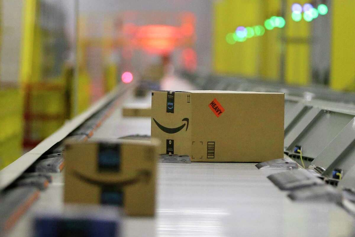 Packages move through the shipping sorter at the Amazon HOU2 Fulfillment Center, 10550 Ella Blvd., Thursday, Sept. 6, 2018, in Houston.