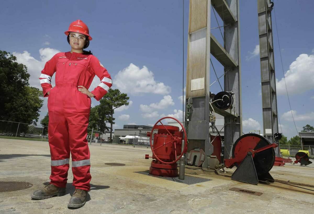 Maysarah Mikail, a Halliburton senior technical professional, poses in her gender-specific coveralls at Halliburton,3000 North Sam Houston Pkwy. East, Friday, Aug. 17, 2018, in Houston.