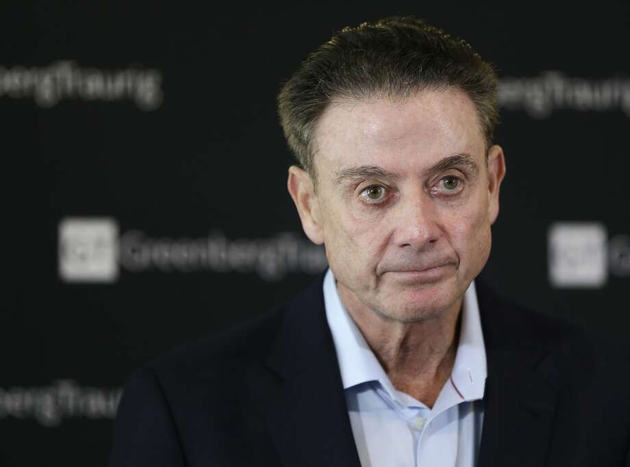 FILE- In this Feb. 21, 2018 file photo, former Louisville basketball Hall of Fame coach Rick Pitino talks to reporters during a news conference in New York. A recruiter, a coach and a former Adidas executive are scheduled to go on trial in New York in a criminal case that exposed corruption in several top U.S. college basketball programs. It also led to the firing of Pitino and sidelined the playing career of standout recruit Brian Bowen Jr. (AP Photo/Seth Wenig, File) Photo: Seth Wenig, Associated Press