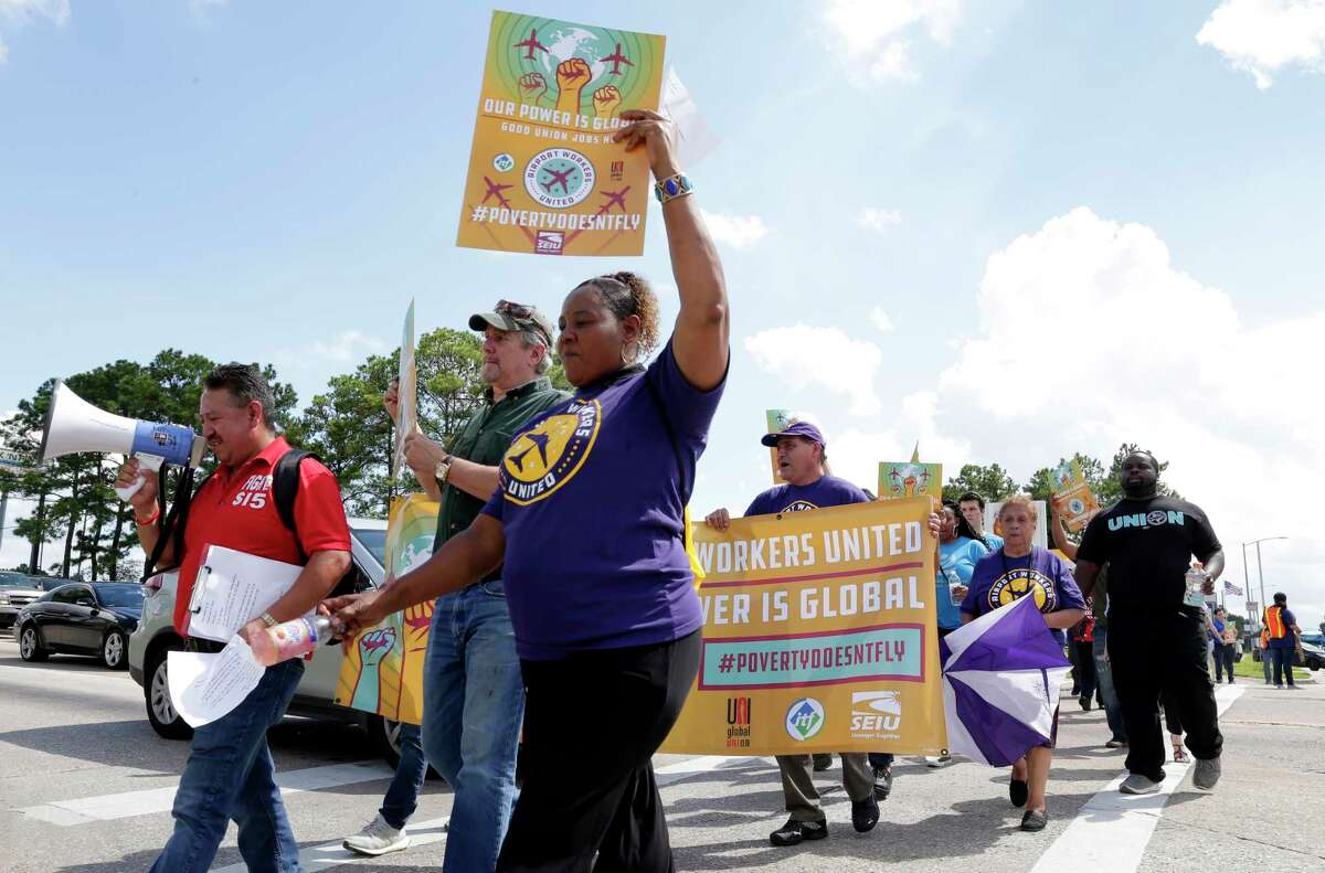 Various groups of airport workers march for higher wages and unionization at the intersection of Greens Road and JFK Blvd., Tuesday, Oct. 2, 2018 near IAH in Houston, TX.