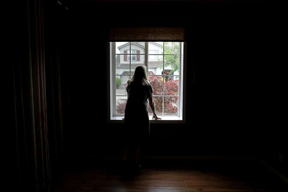 Astrid Granger peers through the window of her new home in Windsor on Friday, July 6, 2018. More than 8 months after the Tubbs Fire destroyed their home in Santa Rosa, the Grangers finally have a home of their own. Photo: Guy Wathen / The Chronicle