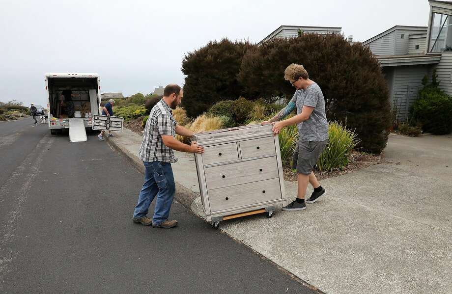 Kenny Crain, left, helps his brother-in-law Cole Geissinger move into a Bodega Bay rental home on Sunday, August 19, 2018. Photo: Guy Wathen / The Chronicle