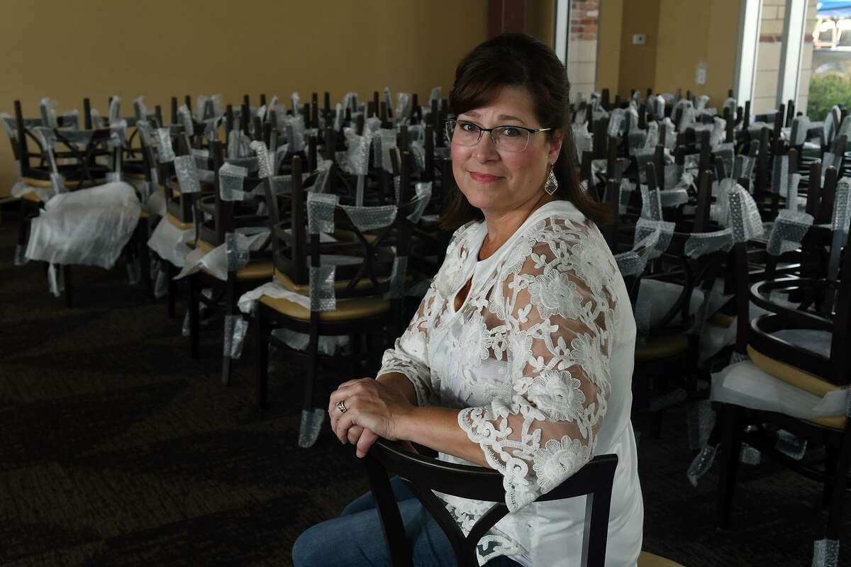 Leslie Raffa, a breast cancer survivor, sits in the dining room of Raffa's Waterfront Grill, owned by her and her husband, in Kings Harbor in Kingwood. The restaurant is still being renovated after taking on five feet of water during Hurricane Harvey.