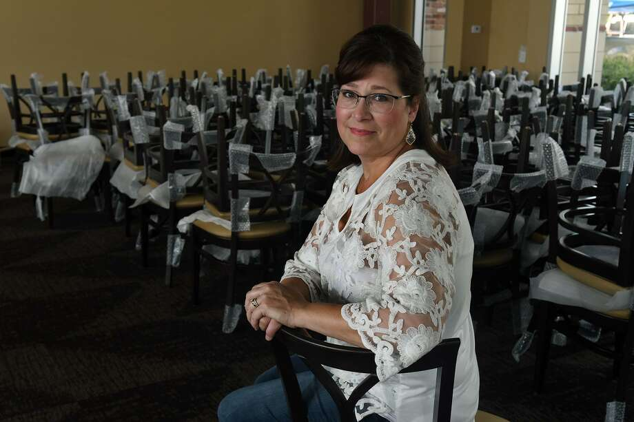 Leslie Raffa, a breast cancer survivor, sits in the dining room of Raffa's Waterfront Grill, owned by her and her husband, in Kings Harbor in Kingwood. The restaurant is still being renovated after taking on five feet of water during Hurricane Harvey. Photo: Jerry Baker, Houston Chronicle / Contributor / Houston Chronicle