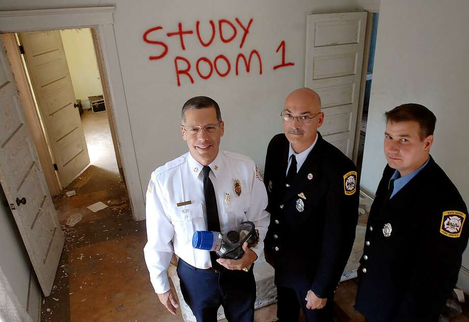 From left, Hamden Fire Chief  David Berardesca, New Haven Firefighter Eric George and Frank Ricci, director of Fire Services for the Connecticut Council on Occupational Safety and Health Inc. Photo: Hearst Connecticut Media File