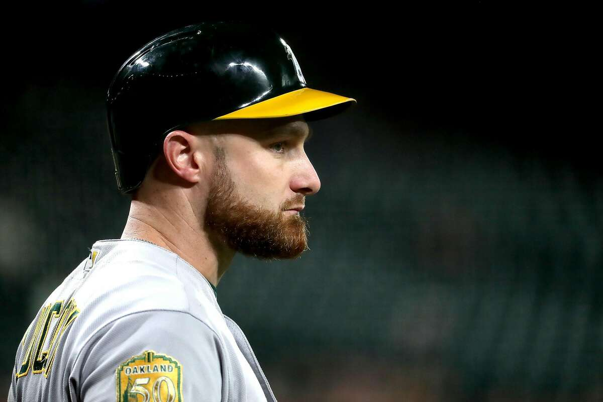 SEATTLE, WA - SEPTEMBER 24: Jonathan Lucroy #21 of the Oakland Athletics looks on against the Seattle Mariners while on deck to bat in the second inning during their game at Safeco Field on September 24, 2018 in Seattle, Washington. (Photo by Abbie Parr/Getty Images)