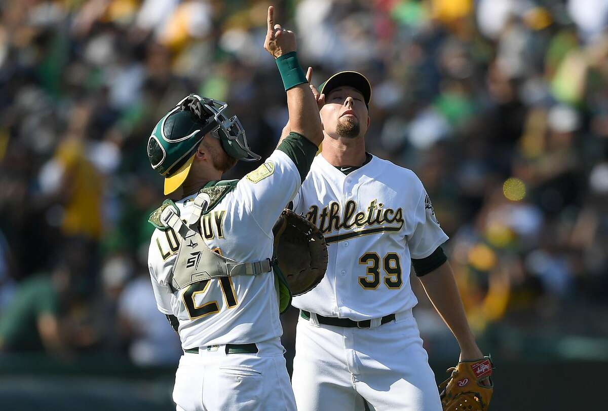 OAKLAND, CA - SEPTEMBER 03: Blake Treinen #39 and Jonathan Lucroy #21 of the Oakland Athletics celebrates defeating the New York Yankees 6-3 at Oakland Alameda Coliseum on September 3, 2018 in Oakland, California. (Photo by Thearon W. Henderson/Getty Images)