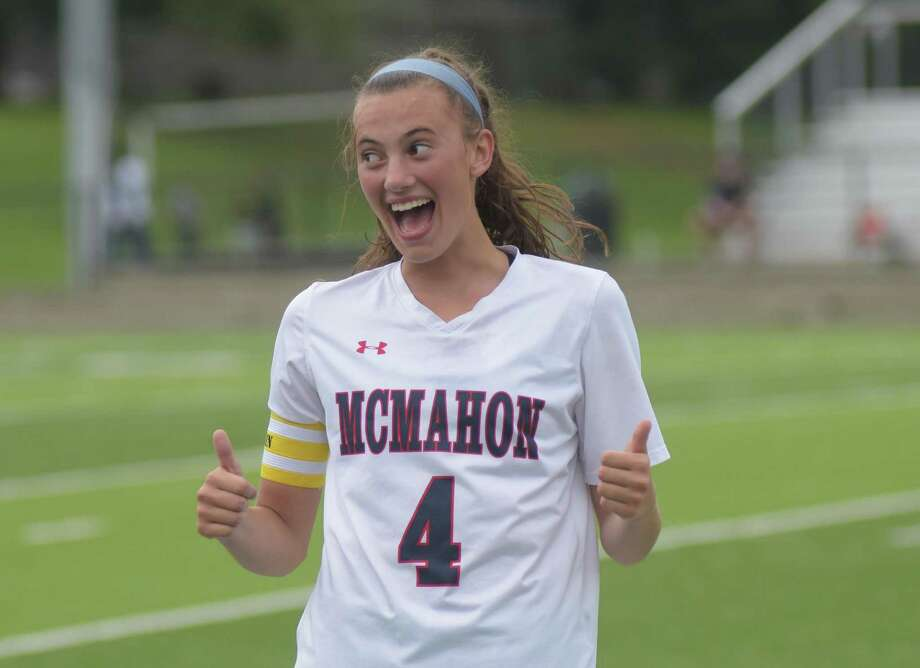 Ortolano jokingly gives her teammates two thumbs up after Tuesday's game was stopped to honor her school-record 38th career goal. Photo: John Nash / Hearst Connecticut Media