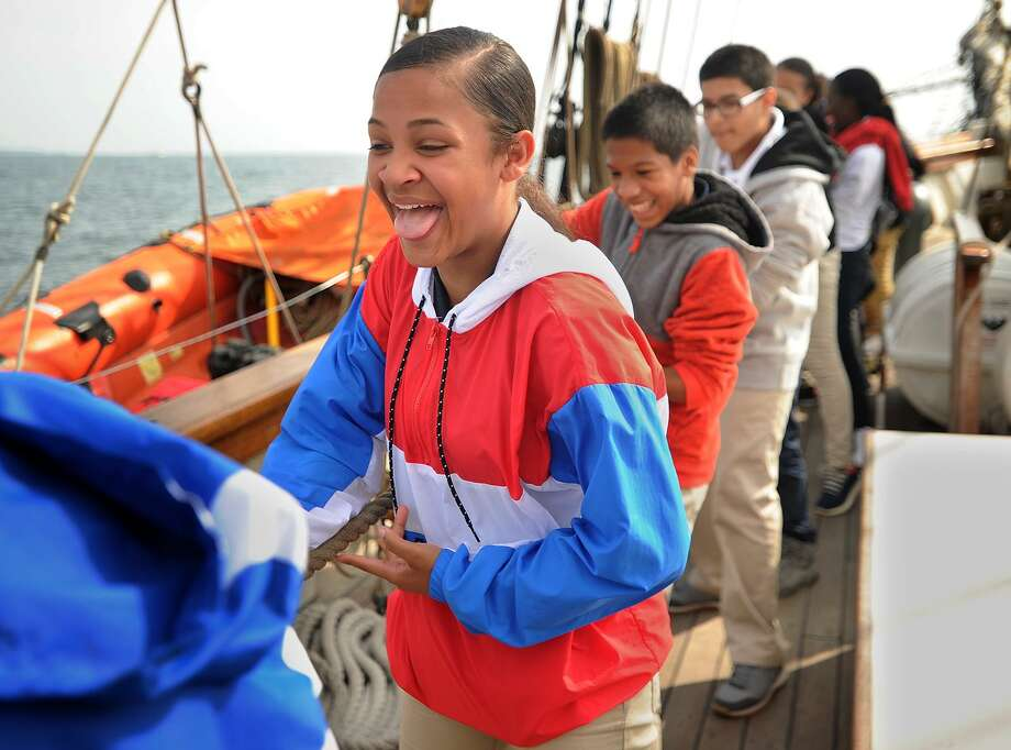 Rosely Martinez, 13, and her classmates from Curiale School in Bridgeport haul a line to raise a sail during a voyage on a replica of Amistad on Long Island Sound off Bridgeport on Tuesday. Photo: Brian A. Pounds / Hearst Connecticut Media / Connecticut Post