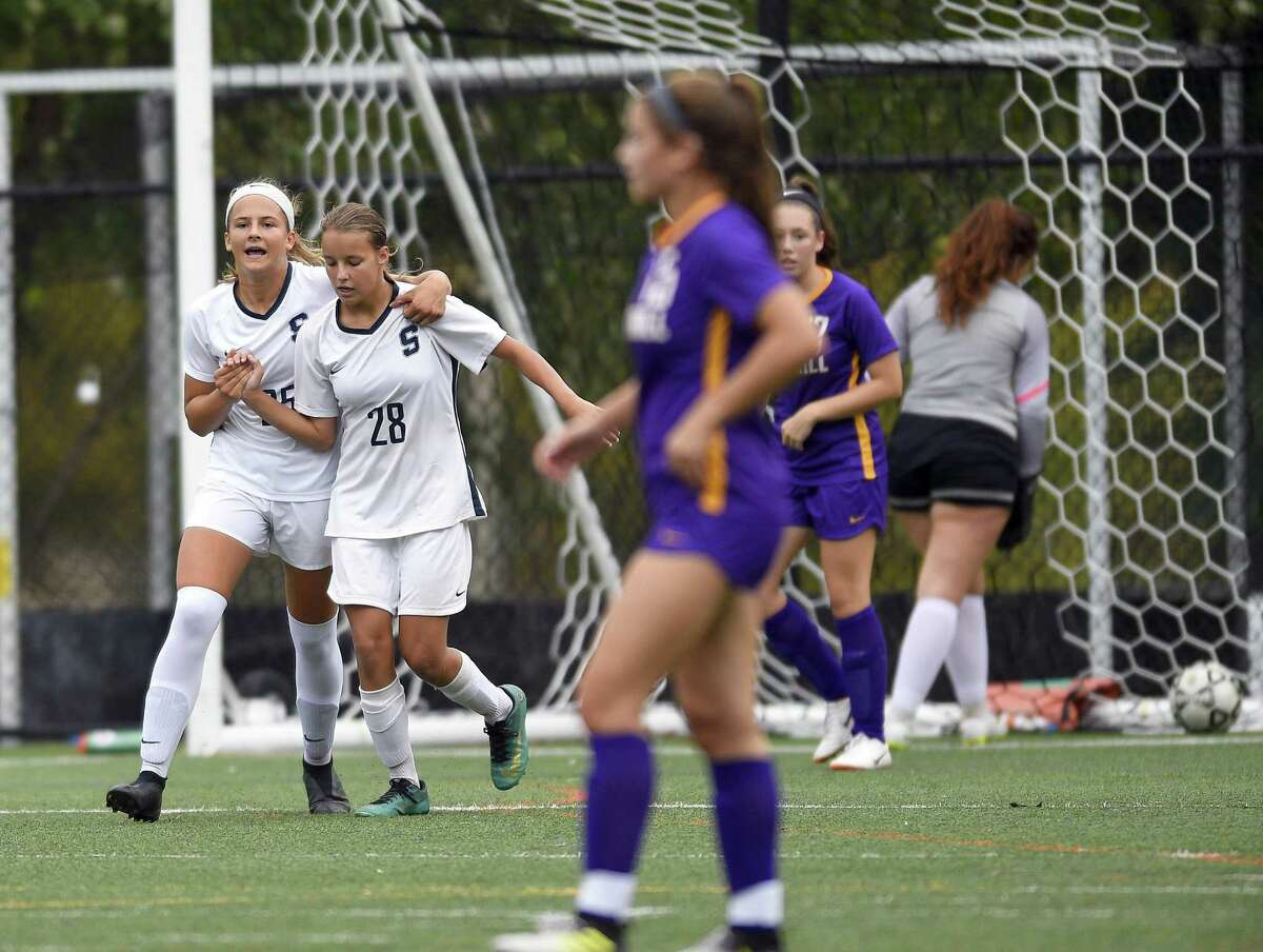 Staples Marlo Von der Ahe (25) celebrates her first half goal against Westhill with teammate Sasha Hamer (28) in a FCIAC girls soccer game on Oct. 2, 2018 in Stamford, Connecticut. Staples defeated Westhill 4-1.