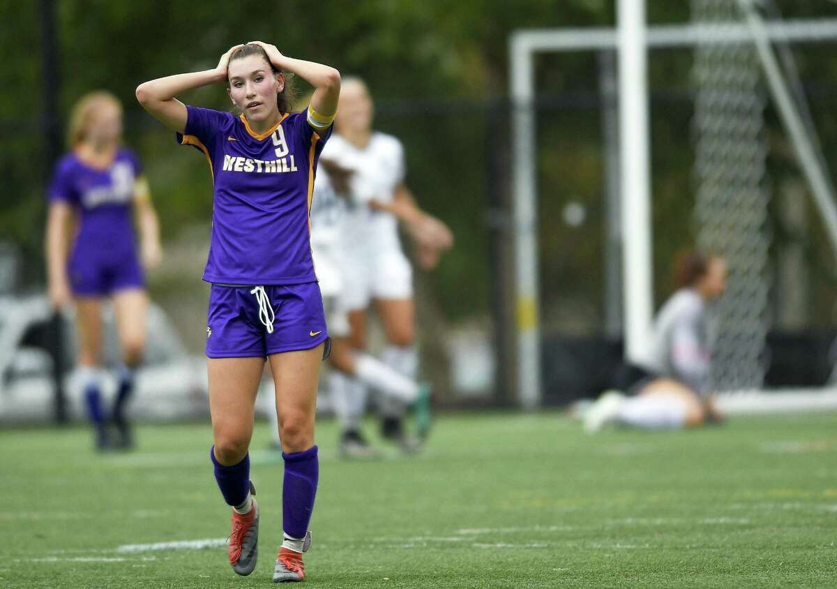 Westhill's Corinne Dente (9) reacts after Staples Ava Simunovic scored on a cornerkick in the first half of an FCIAC girls soccer game on Oct. 2, 2018 in Stamford, Connecticut. Staples defeated Westhill 4-1.