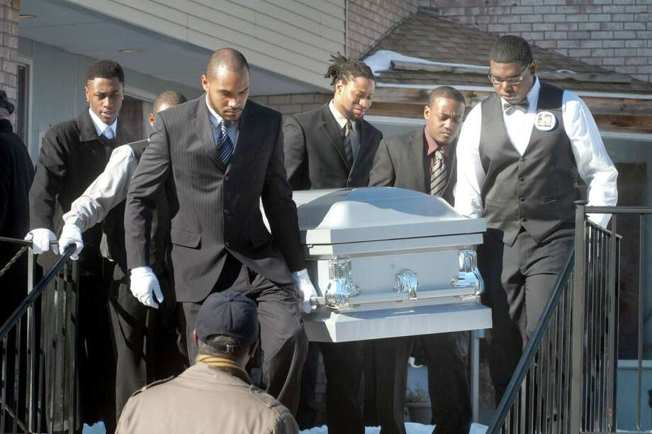 Pallbearers carry the casket to the hearse during the funeral service for Durell Patrick Law in 2014. Photo: Hearst Connecticut Media File Photo /