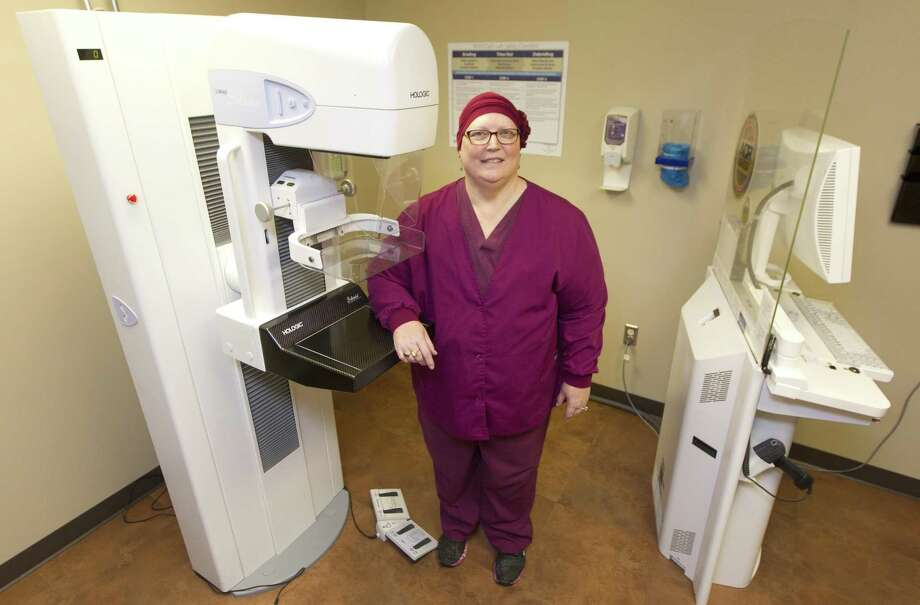 Debbie Martin, a mammography tech at Conroe Regional Medical Center, poses for a portrait on Tuesday, Sept. 11, 2018, in Conroe. Martin stresses the importance of mammograms to her patients as she fights her own battle with breast cancer. Photo: Jason Fochtman, Houston Chronicle / Staff Photographer / © 2018 Houston Chronicle