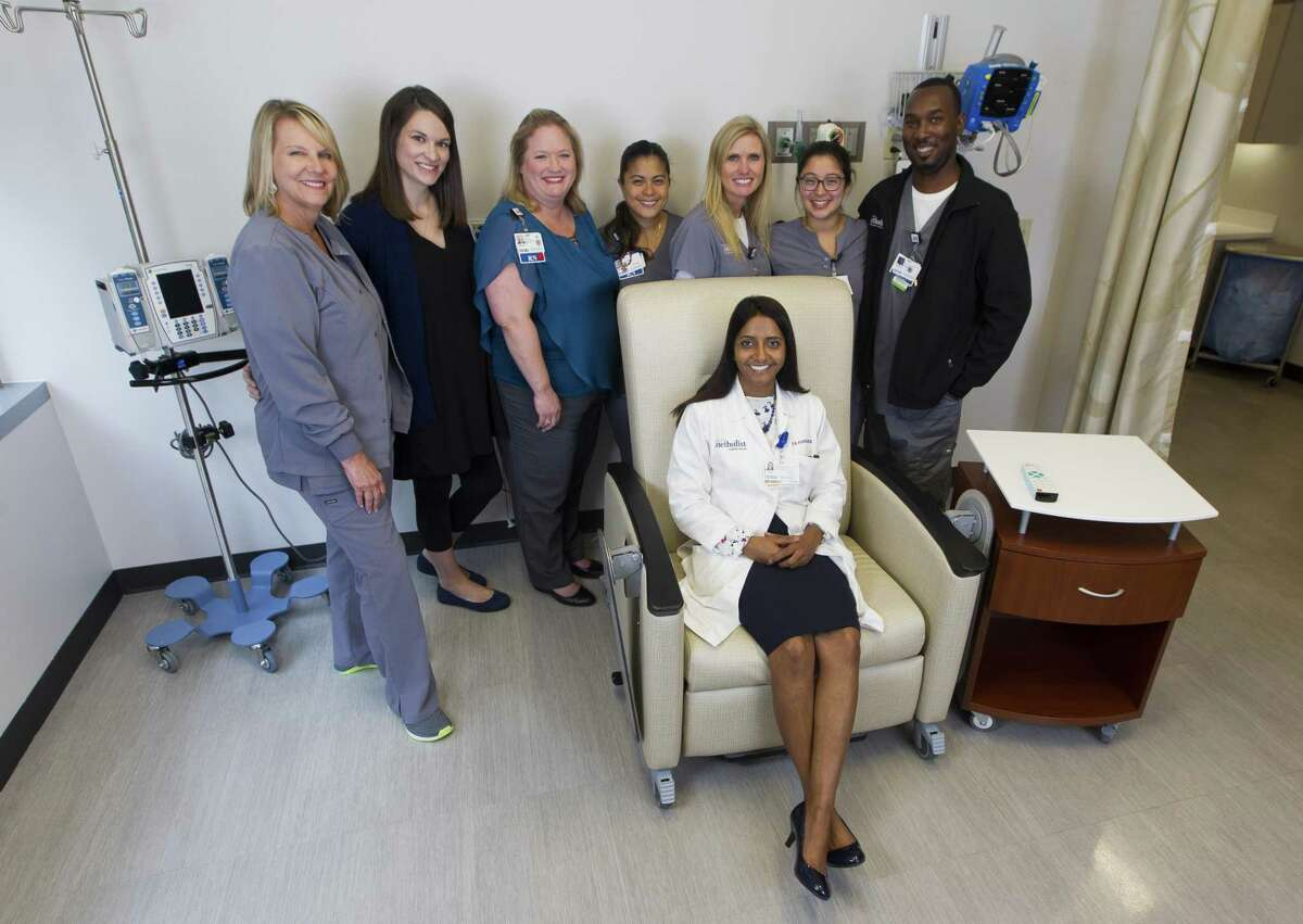 From left to right Cheryl Leheny, Lindsey Pimentel, Whitney Arriaga, Buena Delacruz, Kim Gensler, Ariana Arrambide, Kardaryl Wallace and Dr. Priya Ramshesh (sitting) pose for a photo at Houston Methodist The Woodlands Hospital on Thursday, Sept. 13, 2018, in The Woodlands. This group is the staff of the Infusion Center at HMTW. Because they become so close when their patients, they get creative with celebrations for their patients who have completed their cancer treatment.