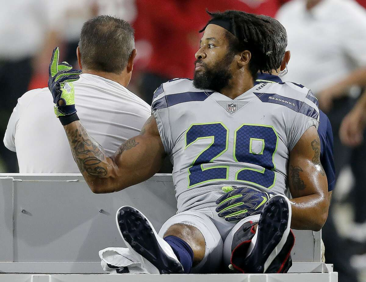 Seattle Seahawks defensive back Earl Thomas (29) gestures to his bench as he leaves the field after breaking his leg against the Arizona Cardinals during the second half of an NFL football game, Sunday, Sept. 30, 2018, in Glendale, Ariz. The Seahawks won 20-17. (AP Photo/Ross D. Franklin)