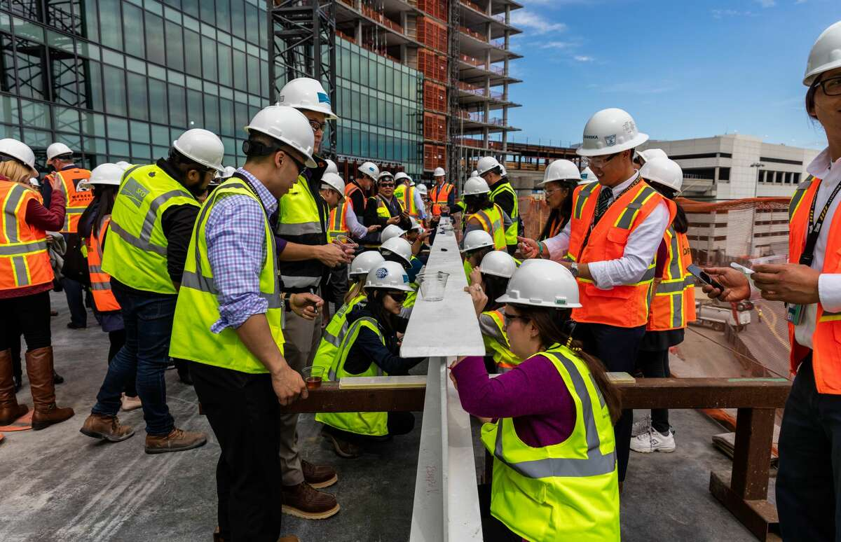 Signing the topmost beam of the new The Grand Hyatt at SFO which will be 12 stories and should open in the summer of 2019.