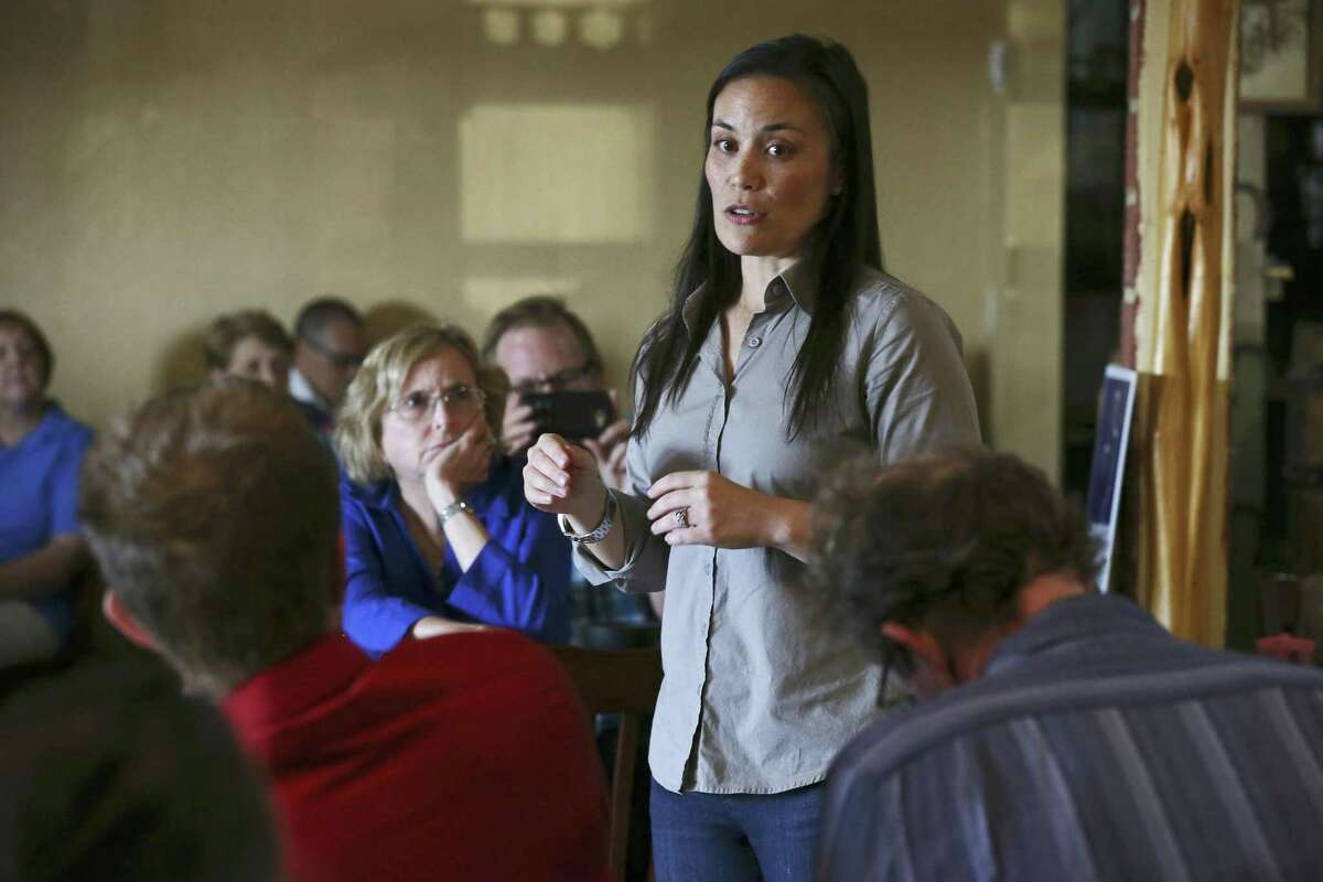 Democratic nominee for Texas' U.S. Congressional District 23 Gina Ortiz Jones addresses the crowd during a meet and greet reception at El Charro Restaurant in Hondo, Texas, Wednesday, August 1, 2018. Ortiz Jones is running against Republican incumbent U.S. Rep. Will Hurd in the November 6 general elections.