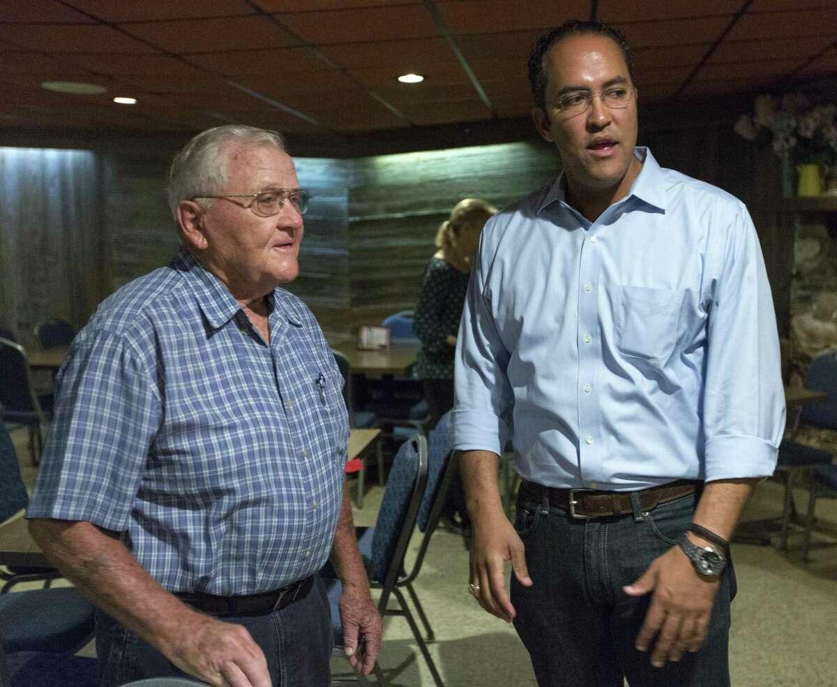 Sammy Tschirhart, left, talks Wednesday, Sept. 20, 2018 with US Representative Will Hurd (R, TX-23) after a Hurd campaign stop at Tschirhart's namesake Castroville restaurant, Sammy's.
