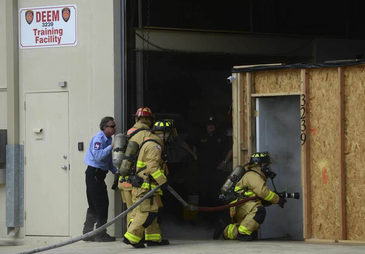 File Photo: San Antonio firefighters train on a simulated home on fire back in October. Officials reported late Sunday night that an SAFD Wildland Team will deploy to California on Monday to help combat recent wildfires.