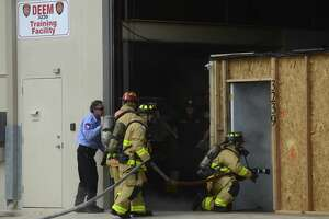 Firefighters enter a simulated home on fire at the Fire Department's new Scott Deem Training Facility on Tuesday, Oct. 2, 2018, which was built in the wake of a mall blaze that killed firefighter Deem and left two others injured. The structure allows firefighters to go through training exercises to escape entrapments, entanglements and zero-visibility conditions. The tour Tuesday came as the San Antonio Fire Department braces for a federal report examining the circumstances surrounding Deem's death.