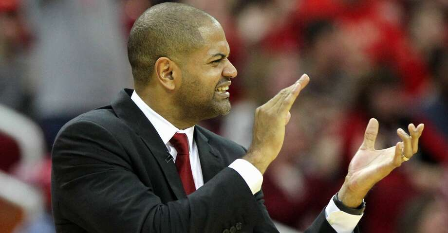 Houston Rockets head coach J.B. Bickerstaff cheers for his team during a timeout against the San Antonio Spurs in the second half of an NBA game played on Christmas Day at the Toyota Center Friday, Dec. 25, 2015, in Houston. Rockets won 88-84. ( Gary Coronado / Houston Chronicle ) Photo: Gary Coronado/Houston Chronicle