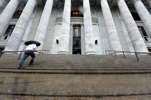 Persistent rainfall made life difficult for lunchtime foragers outside the State Education Building on Tuesday, Oct. 2, 2018, on Washington Avenue in Albany, N.Y. (Will Waldron/Times Union)