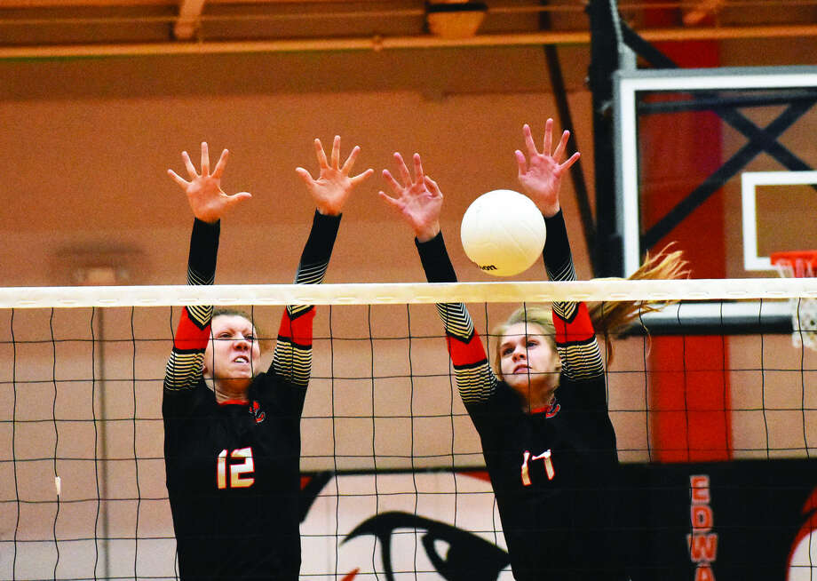 Edwardsville's Morgan Tulacro, left, and Storm Suhre go up for a successful block during Tuesday's match against O'Fallon at Lucco-Jackson Gymnasium. Photo: Matthew Kamp