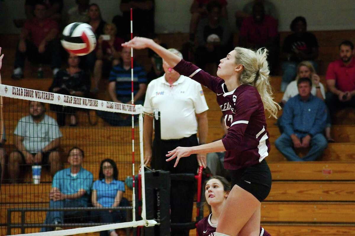 Clear Creek's Allie Garland (17) delivers a kill against Clear Brook Tuesday night.