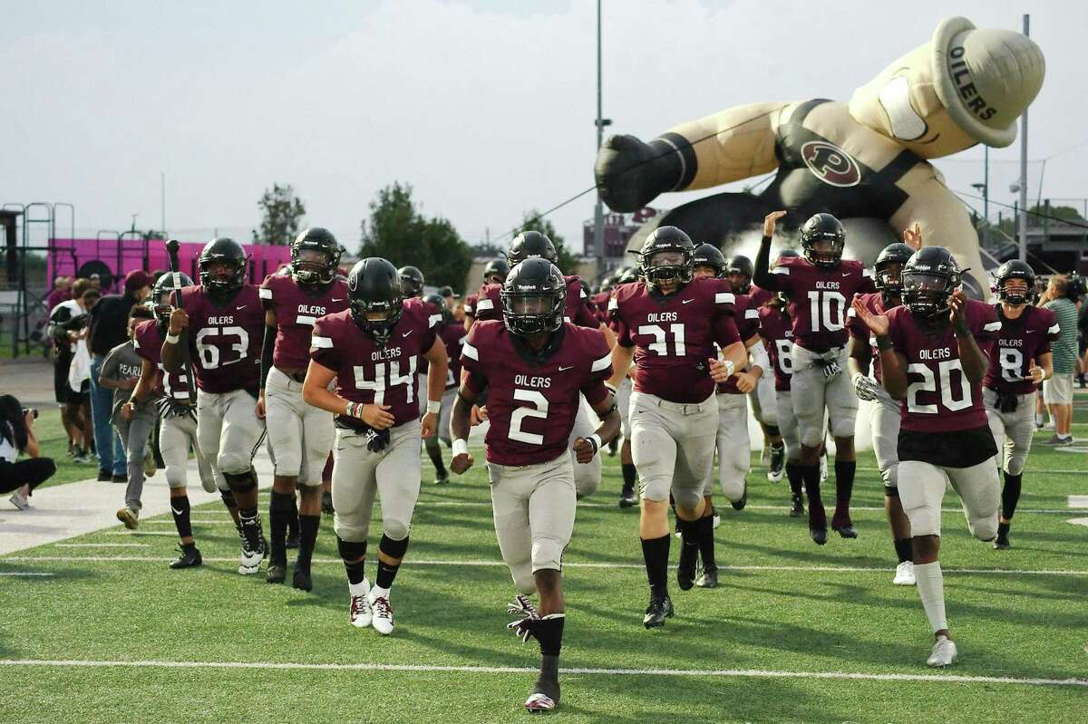 Pearland takes the field before its game against Alief Taylor last Friday. The Oilers play rival Dawson this Friday at the University of Houston.