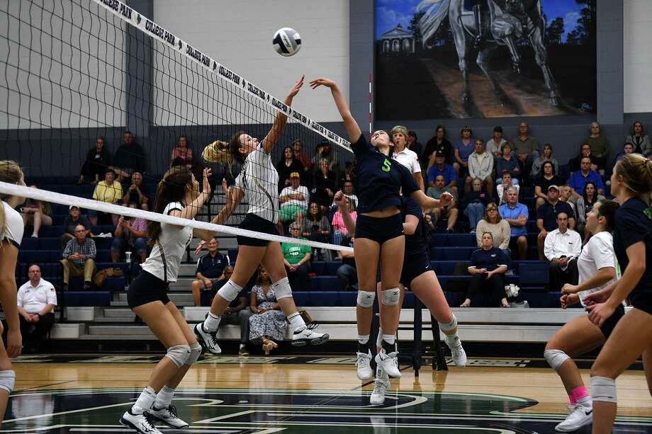 College Park middle hitter Abby Kremer (5) makes a play at the net against Klein Collins senior outside hitter Sammy Normand, left, during the first set of their District 15-6A matchup at College Park High School on Tuesday, Oct. 2, 2018. Photo: Jerry Baker, Houston Chronicle / Contributor / Houston Chronicle