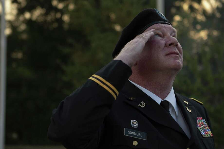 "Woodlands attourney colonel Oscar ""Jack"" Sommers salutes the Lone Star Flag shortly after raising it duriing a flag raising ceremony Tuesday, Oct. 2, 2018 at The Lone Star Memorial and Historical Flag Park in Conroe. Photo: Cody Bahn, Houston Chronicle / Staff Photographer / © 2018 Houston Chronicle"