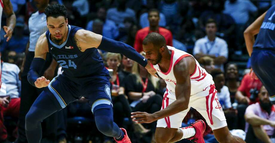 Houston Rockets guard Chris Paul (3) and Memphis Grizzlies guard Dillon Brooks (24) scramble for a loose ball during the first half of a preseason NBA basketball game, Tuesday, Oct. 2, 2018, in Birmingham, Ala. (AP Photo/Butch Dill) Photo: Butch Dill/Associated Press
