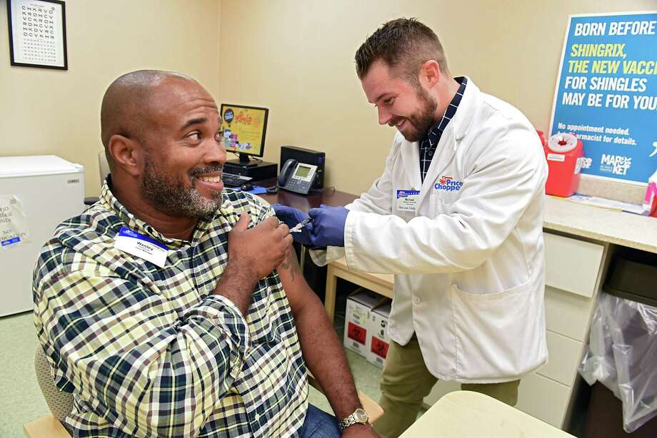 Price Chopper store manager Wesley Holloway gets a flu shot from Price Chopper pharmacist Mike Barkley on Tuesday, Oct. 2, 2018 in Loudonville, N.Y. (Lori Van Buren/Times Union) Photo: Lori Van Buren / 20045016A