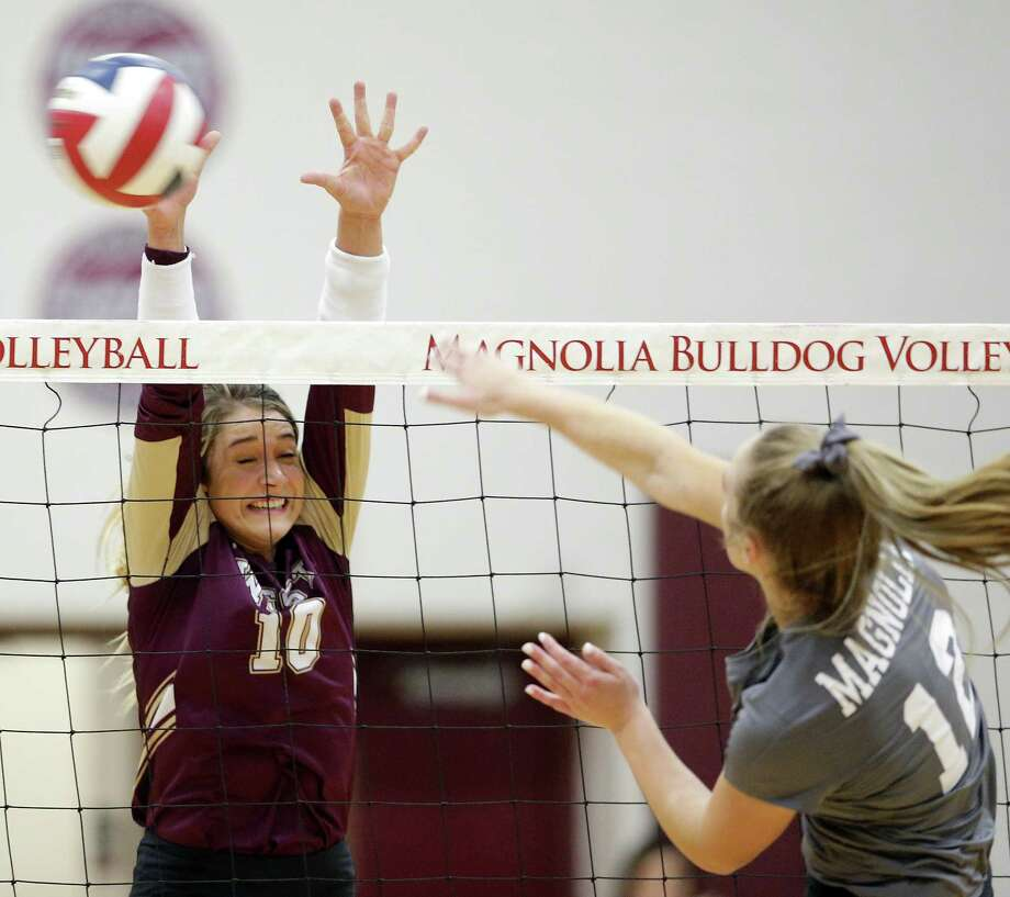 Magnolia West's Rylie Scales (10) defends the spike by Magnolia's Sydney Gentry (12) during their match at Magnolia High School, Tuesday, Oct. 2, 2018 in Magnolia, TX. Photo: Michael Wyke, Houston Chronicle / Contributor / © 2018 Houston Chronicle