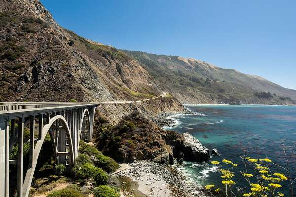 Bixby Bridge on Highway 1 is a highlight of the drive along the Pacific coast near Big Sur, Calif., Sept 13, 2018. The road was built in pieces starting about a century ago, partly with prison labor and explosives; pieces of it still close, for fires, for eroded bridges, for falling right into the ocean. (Drew Kelly/The New York Times)