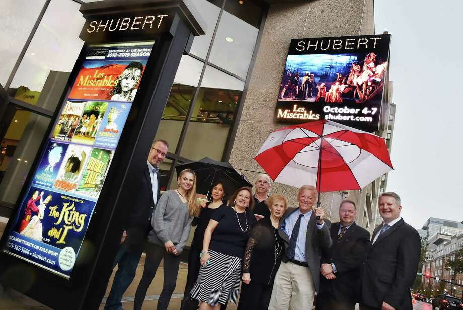 The Shubert has a new marquee in time for the holidays. Members of the Shubert Theatre administration stand at the entrance to the landmark theater on College Street in New Haven. They were unveiling the new digital marquee as seen above, on Tuesday, Oct. 2, 2018. The new digital marquee was made possible by a donation from Susan Weinstein in memory of her husband, Richard. It replaces the former 30-year-old marquee. Photo: Catherine Avalone, Hearst Connecticut Media / New Haven Register