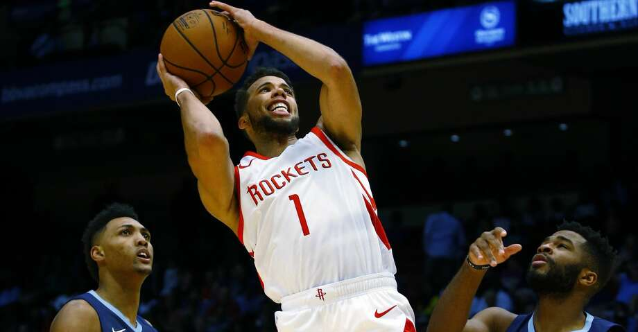 Houston Rockets guard Michael Carter-Williams (1) puts up a shot over Memphis Grizzlies center Doral Moore (14) and guard Andrew Harrison (5) during the second half of a preseason NBA basketball game, Tuesday, Oct. 2, 2018, in Birmingham, Ala. Houston Rockets won 131-115. (AP Photo/Butch Dill) Photo: Butch Dill/Associated Press